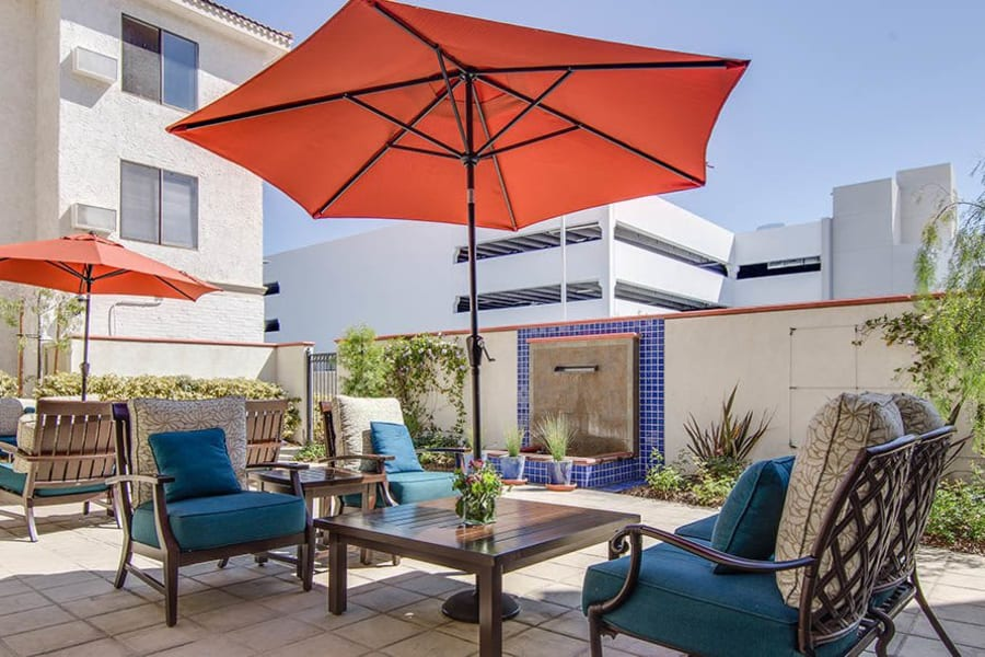 Outdoor patio with comfortable seating at The Commons at Woodland Hills in Woodland Hills, California