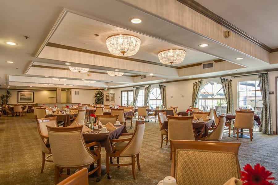 Spacious dinning room with plenty of seating and bright lighting atThe Commons at Woodland Hills in Woodland Hills, California