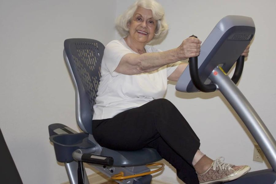 Senior using an individual workout station at The Commons at Woodland Hills in Woodland Hills, California