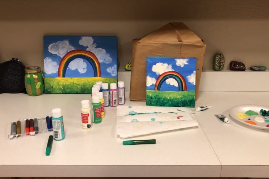 Supplies and artwork at the acrylic painting and wine social at Bella Vista Senior Living in Mesa, Arizona