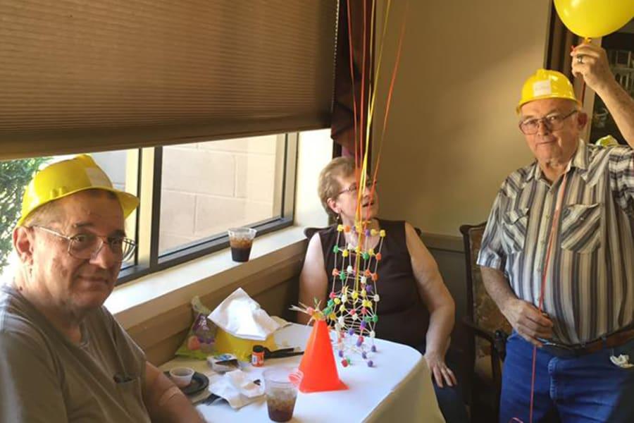 Residents chatting at the dining room construction kick-off party at Bella Vista Senior Living in Mesa, Arizona