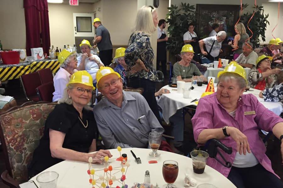 Residents carousing at the dining room construction kick-off party at Bella Vista Senior Living in Mesa, Arizona