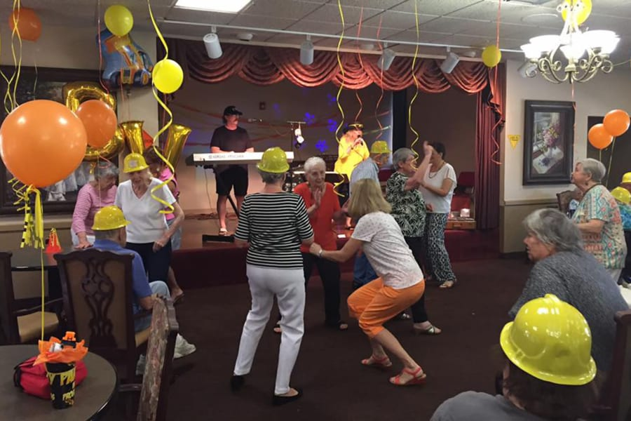 Residents and staff getting funky on the dance floor at the dining room construction kick-off party at Bella Vista Senior Living in Mesa, Arizona