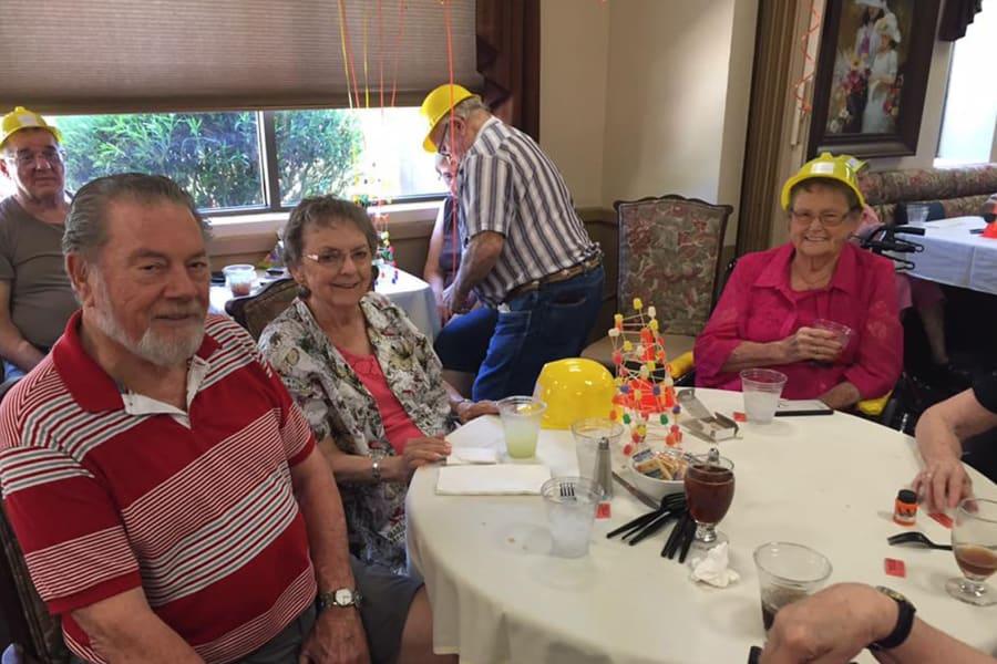 Residents and staff enjoying the party at the dining room construction kick-off at Bella Vista Senior Living in Mesa, Arizona