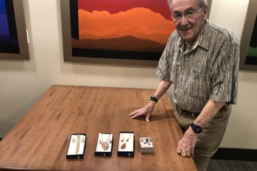 Resident showcasing his jewelry at the show and tell crafts event at Bella Vista Senior Living in Mesa, Arizona