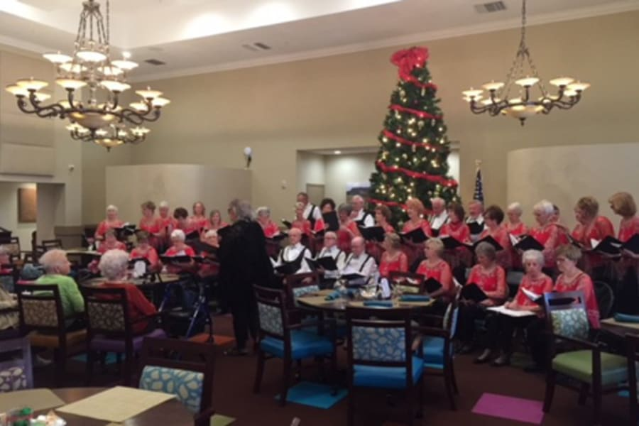 Residents enjoying the Westbrook Village Voices choir at Casa Del Rio Senior Living in Peoria, Arizona
