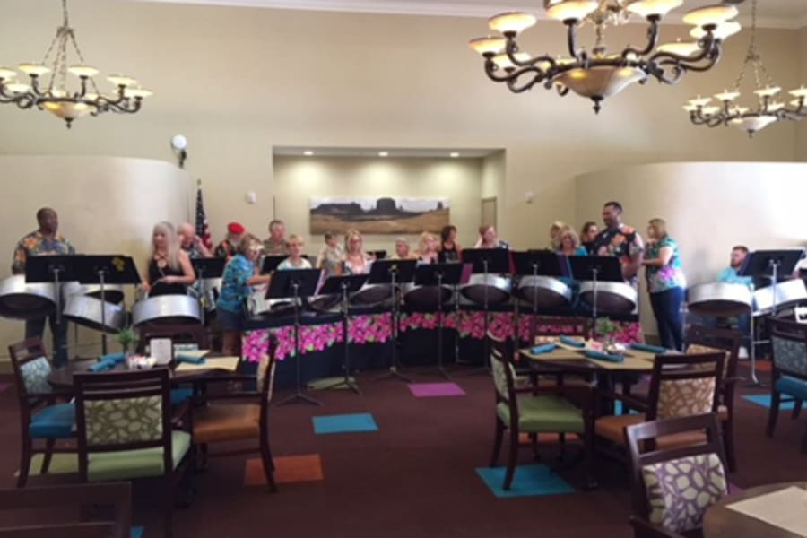 Residents listening to the Desert Winds Steel Orchestra at Casa Del Rio Senior Living in Peoria, Arizona