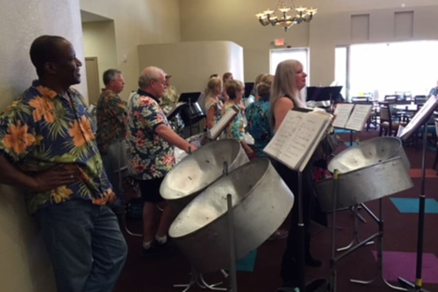 Desert Winds Steel Orchestra performers in action at Casa Del Rio Senior Living in Peoria, Arizona