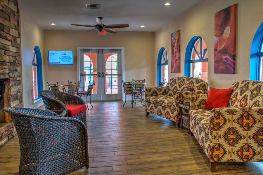 Hardwood floors and comfortable seating in front of the fireplace at Casa Del Rio Senior Living in Peoria, Arizona