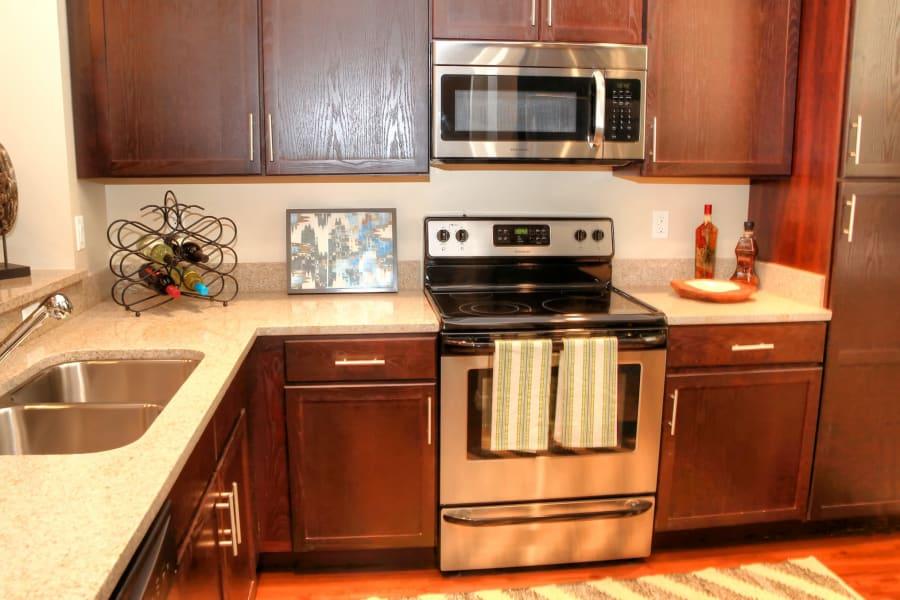 Modern kitchen with stainless-steel appliances in a model senior apartment at Riverwalk Pointe in Jupiter, Florida