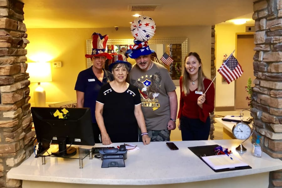 Festive staff posing for a photo at the Fourth of July celebration at Bella Vista Senior Living in Mesa, Arizona