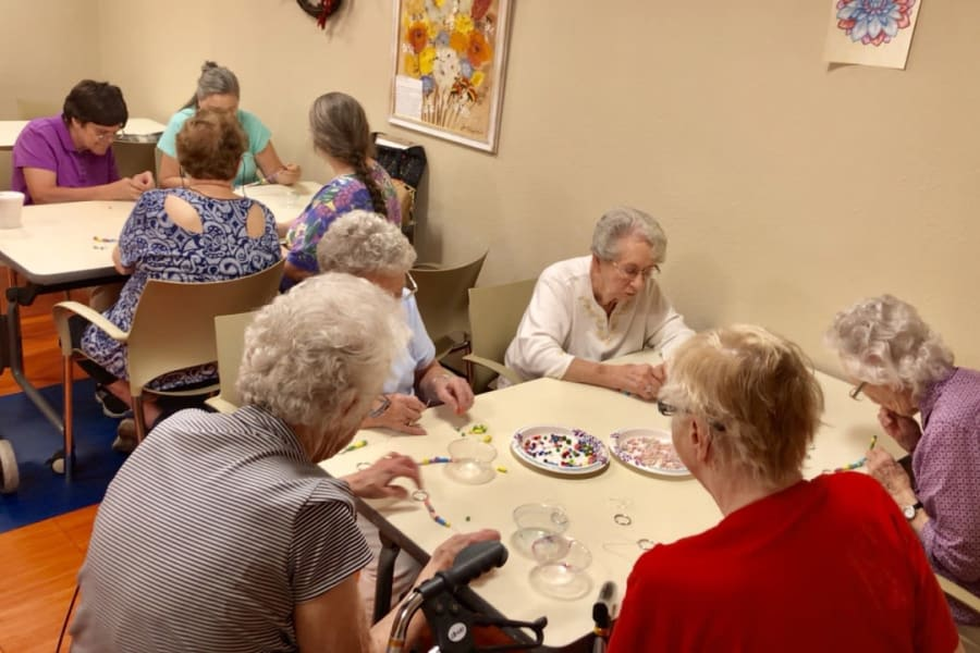 Making keychains in a crafts class at Bella Vista Senior Living in Mesa, Arizona