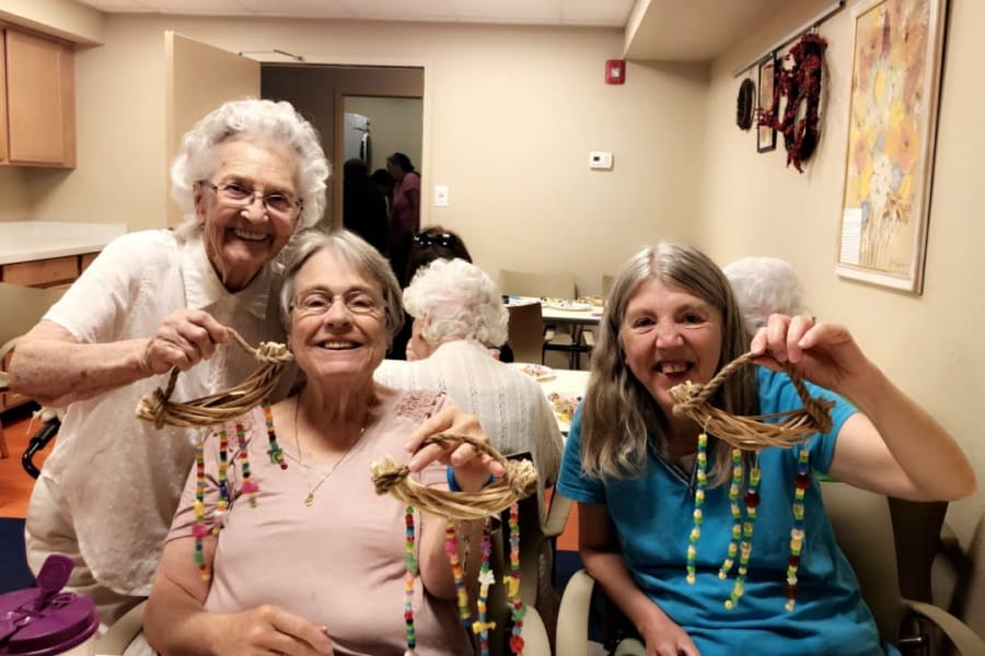 Making wind chimes in a crafts class at Bella Vista Senior Living in Mesa, Arizona