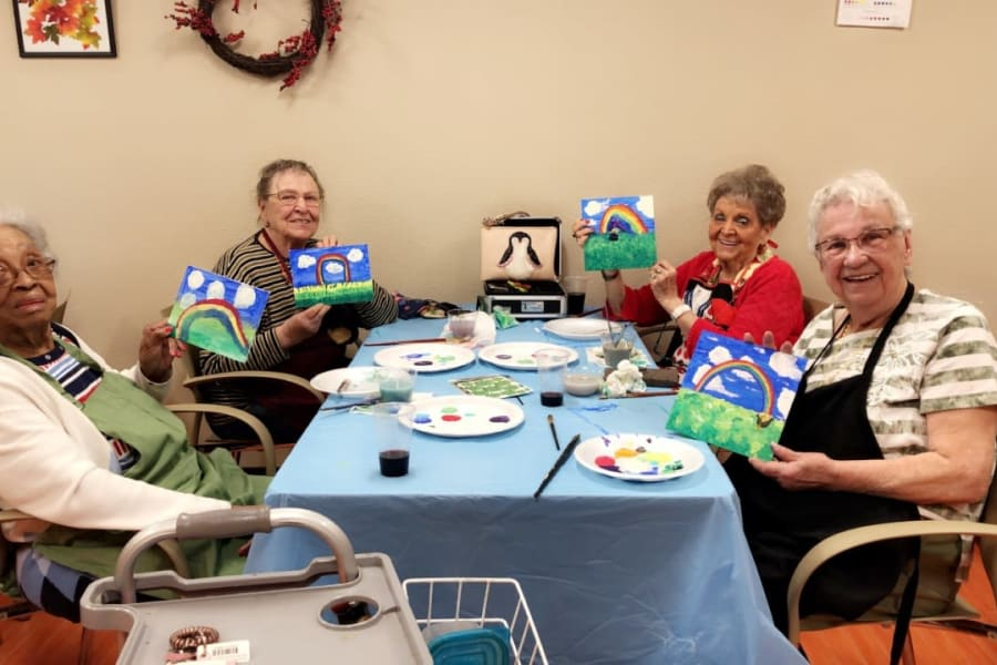 Sipping wine and painting with acrylics in an art class at Bella Vista Senior Living in Mesa, Arizona
