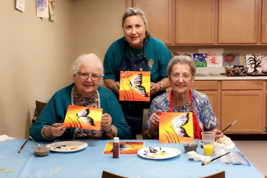 Sipping mimosas and painting butterflies at Bella Vista Senior Living in Mesa, Arizona
