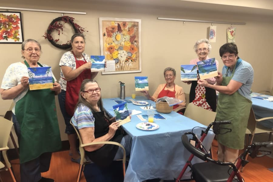 Residents posing for a photo in an art class at Bella Vista Senior Living in Mesa, Arizona