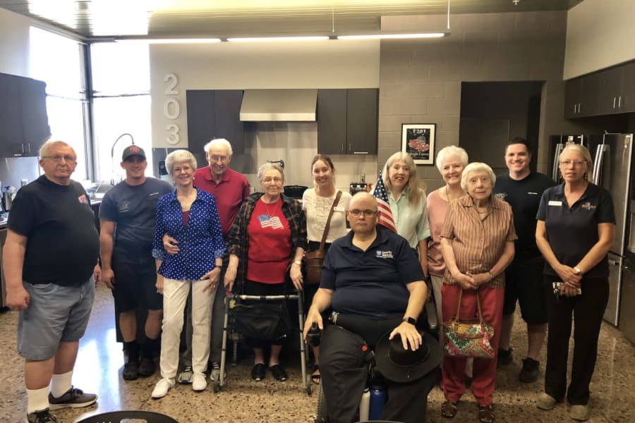 Residents visiting the fire station near Casa Del Rio Senior Living in Peoria, Arizona