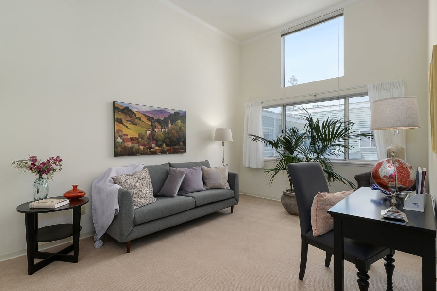 Spacious living room in one of our resident suites at Palo Alto Commons in Palo Alto, California