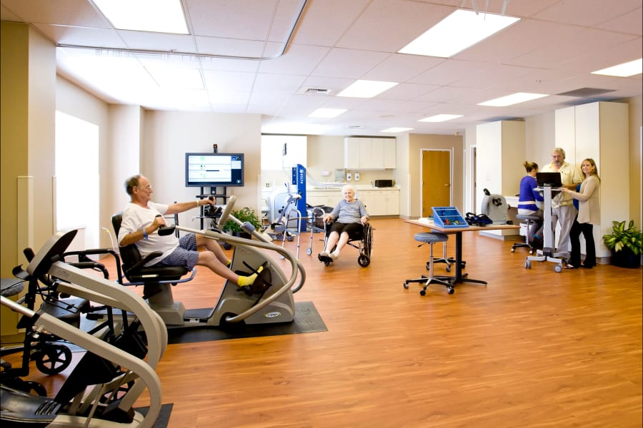 Residents in the fitness room at a Careage community.