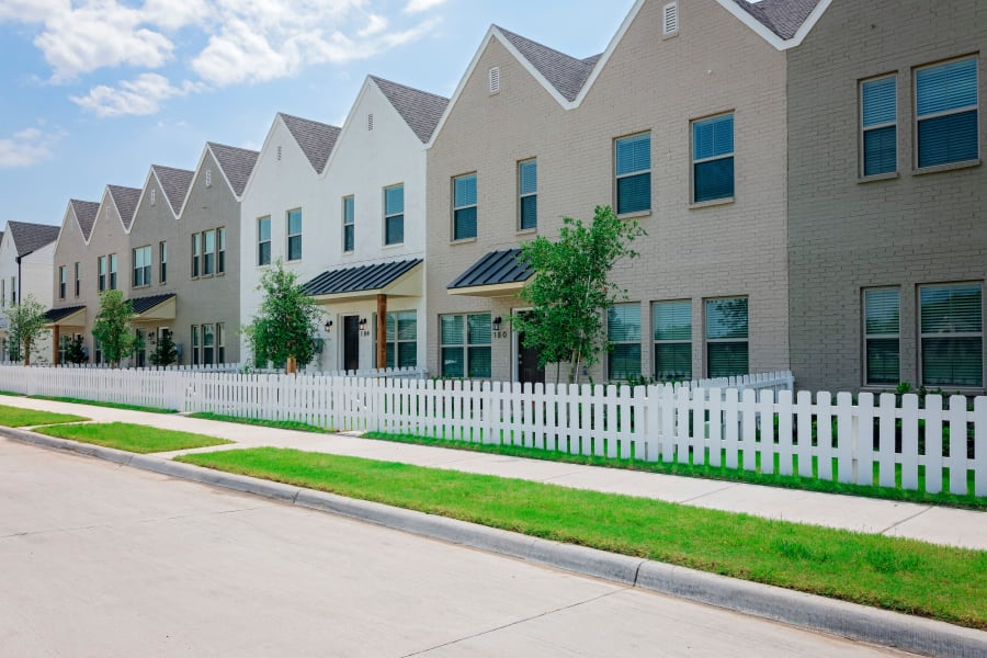 Outside townhomes of The Townhomes at BlueBonnet Trails in Waxahachie, Texas