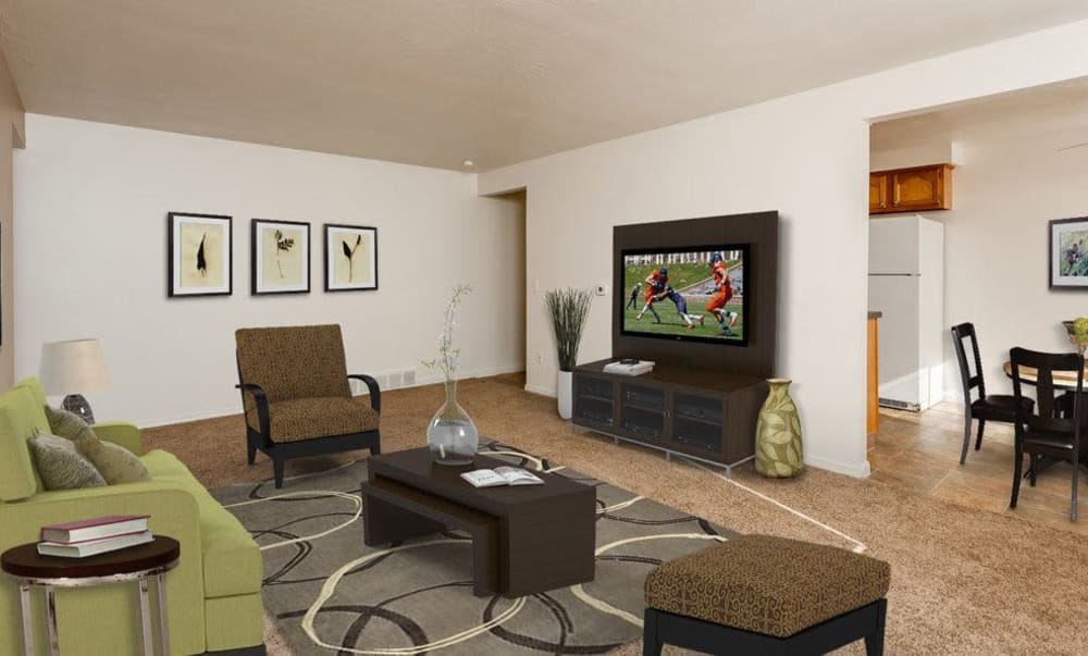 Spacious living room at East Ridge Manor Apartments in Rochester, New York