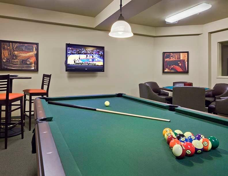 Play pool at Affinity at South Hill's on-site pub