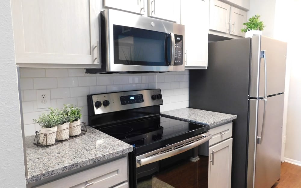 Kitchen with a stainless-steel sink at Royal Palms in San Antonio, Texas