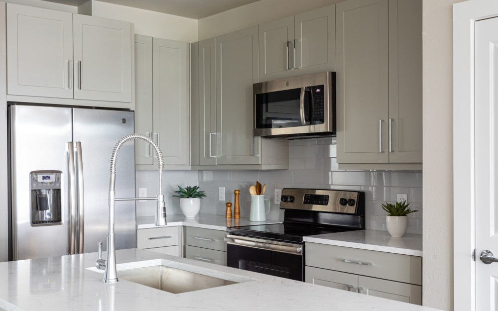 White carrera-style quartz countertops at Opal at Barker Cypress in Houston, Texas