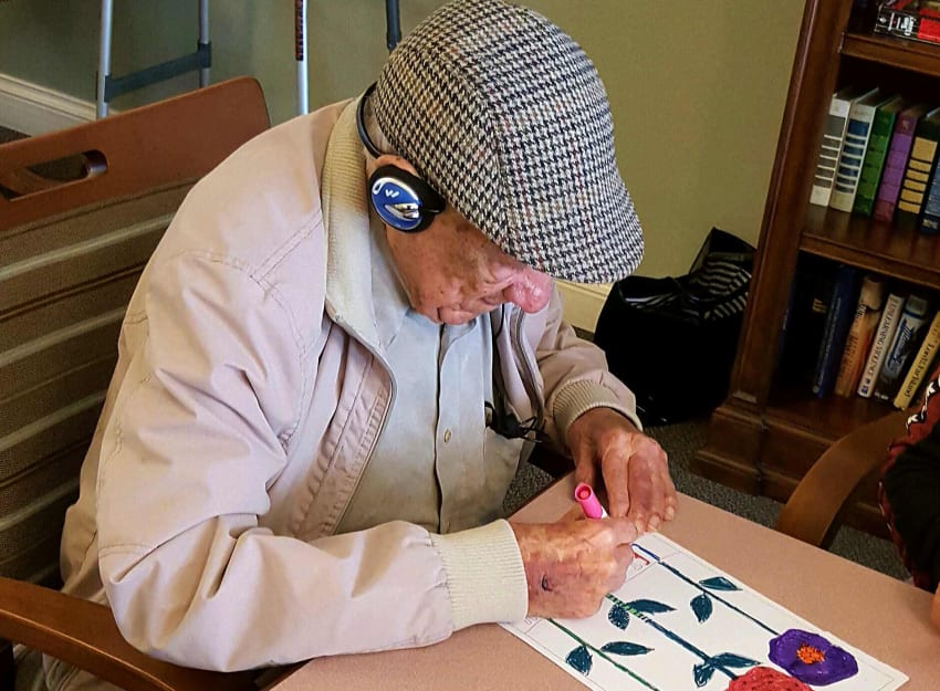 Resident painting at Peninsula Reflections in Colma