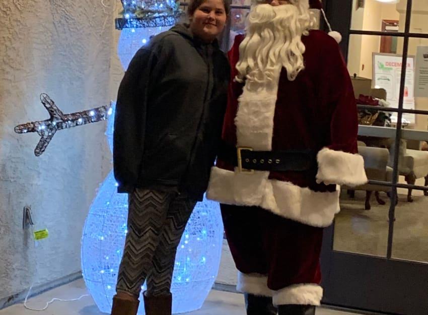 Resident with Santa at Golden Pond Retirement Community in Sacramento