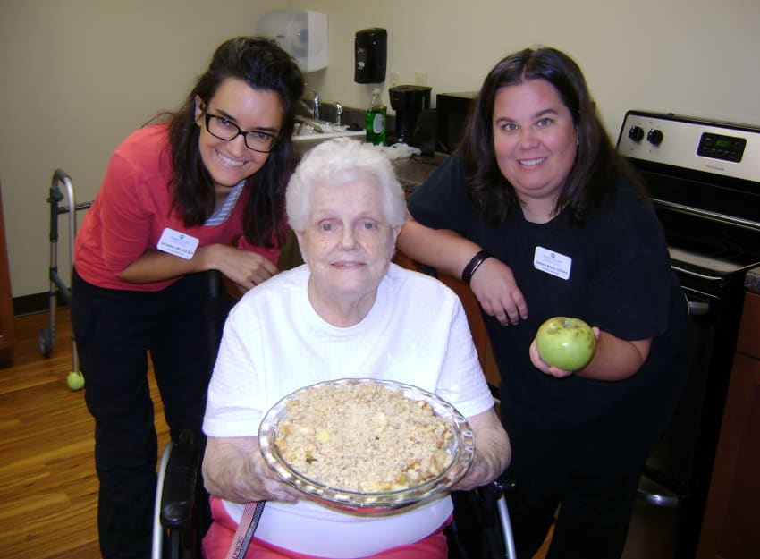 Staff with a resident at Ramsey Village Continuing Care in Des Moines, Iowa