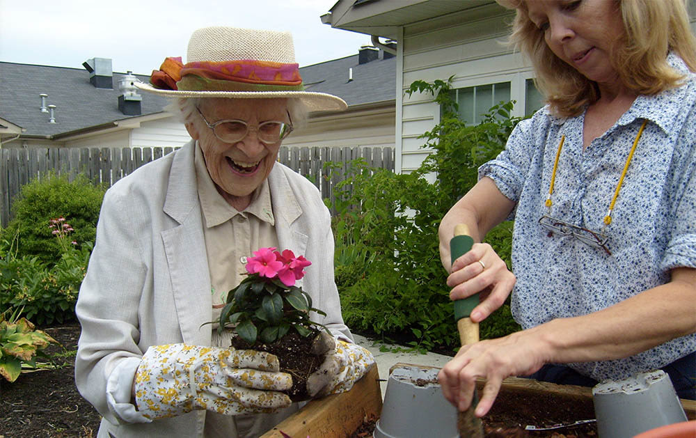 Residents planting together at Heritage Green Assisted Living and Memory Care in Lynchburg, Virginia