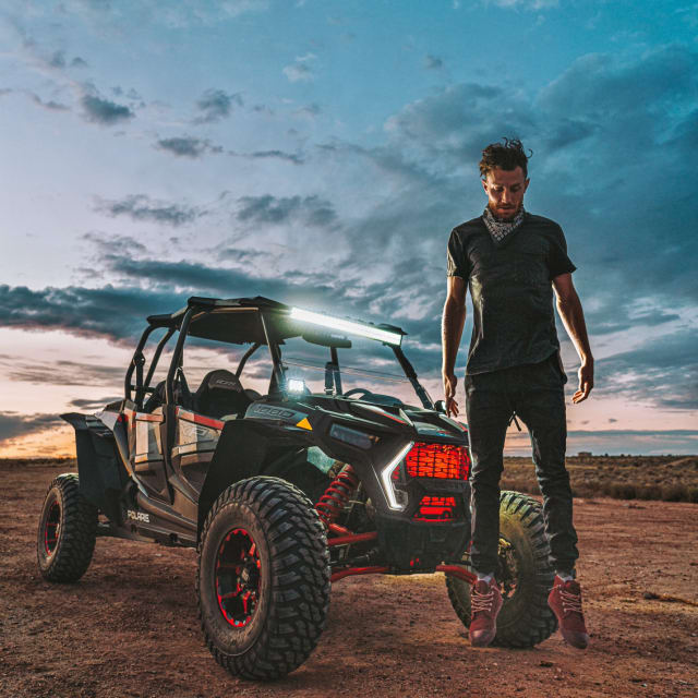 Man standing next to off road vehicle