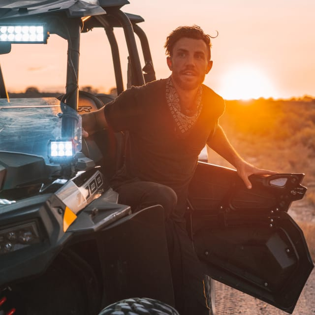 Man sitting in off road vehicle