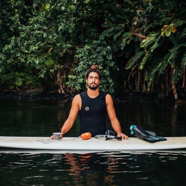 Man sitting surf board