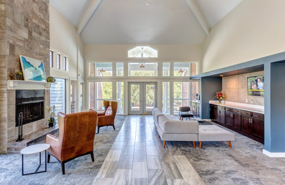 Luxurious resident clubhouse with a fireplace at Lyric on Bell in Antioch, Tennessee