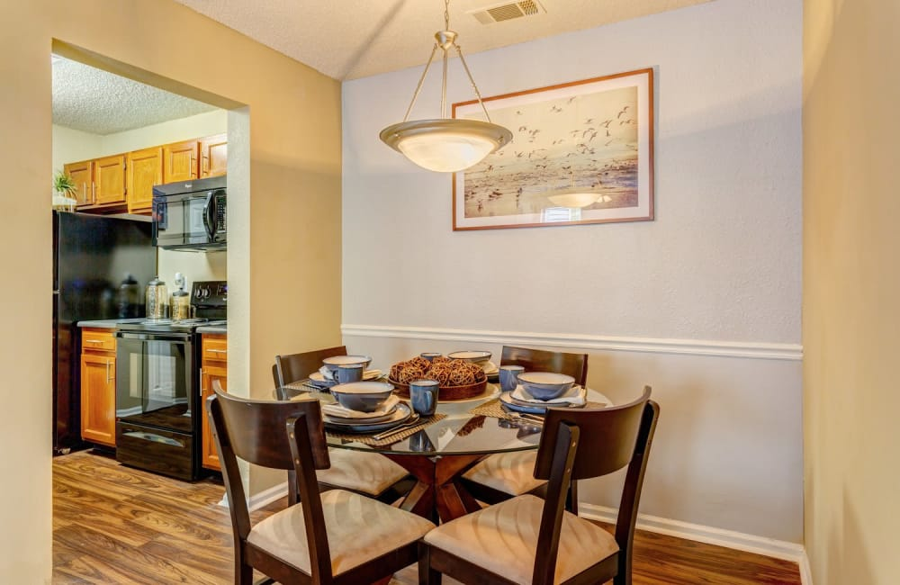 Dining nook with hardwood floors and custom lighting in model home at Lyric on Bell in Antioch, Tennessee