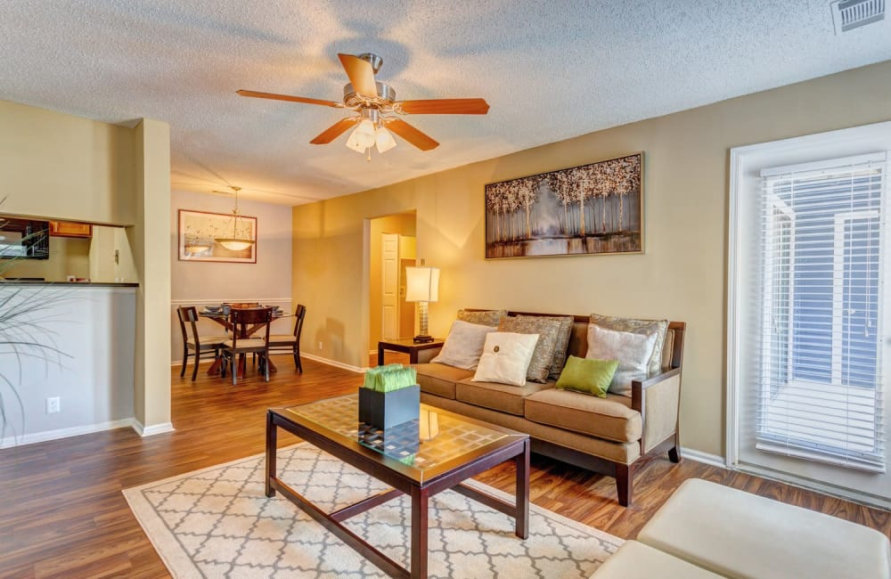 Ceiling fan and hardwood floors in open-concept floor plan of model home at Lyric on Bell in Antioch, Tennessee