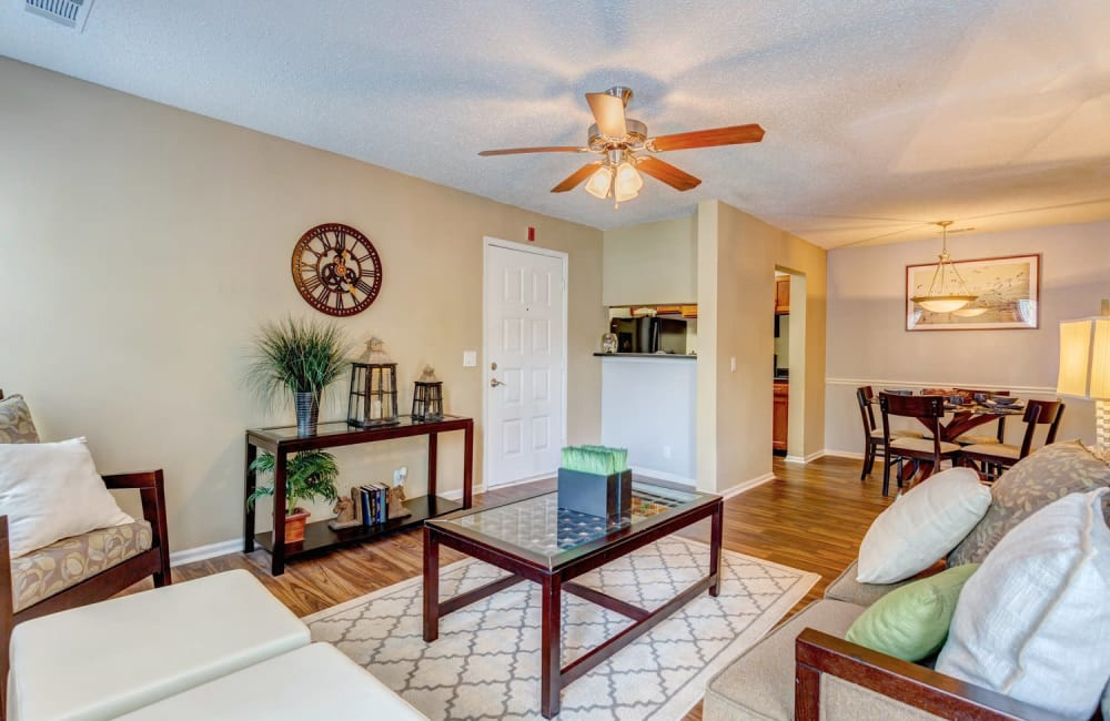Spacious living area with hardwood floors and ceiling fan in open-concept floor plan of model home at Lyric on Bell in Antioch, Tennessee