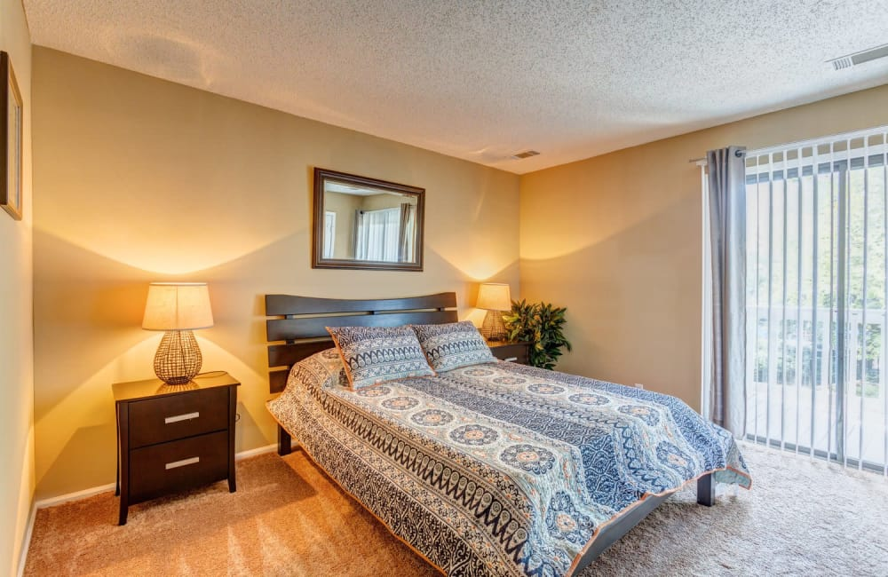 Bedroom with sliding door to private patio of model home at Lyric on Bell in Antioch, Tennessee