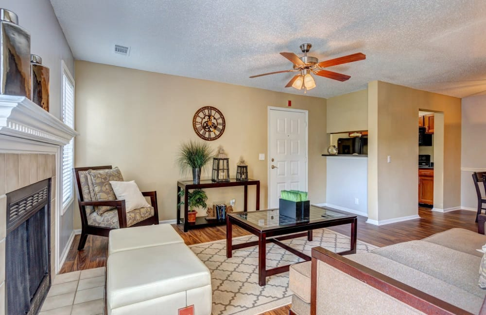Fireplace and ceiling fan in well-decorated living area of model home at Lyric on Bell in Antioch, Tennessee