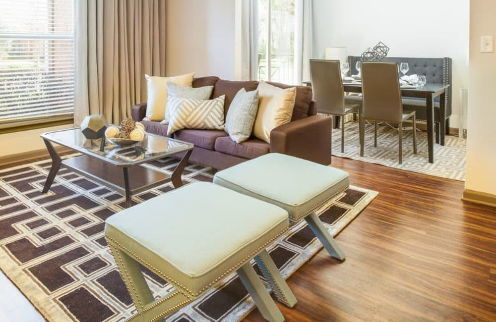 Hardwood floors and bay windows in living area of model home at Presley Oaks in Charlotte, North Carolina