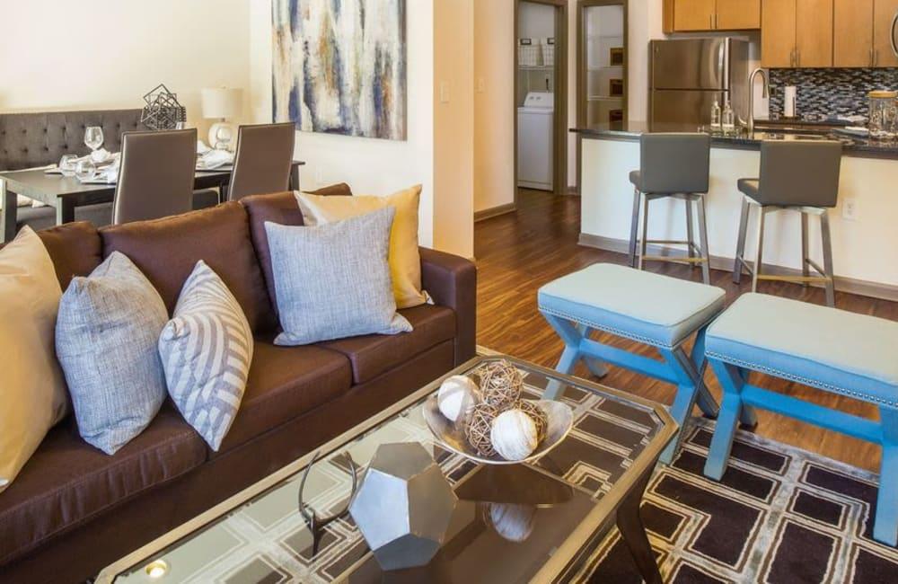 Modern decor in open-concept living area of model home at Presley Oaks in Charlotte, North Carolina