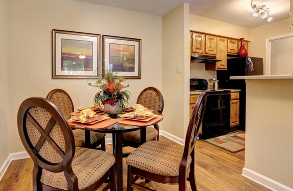 Dining nook with hardwood floors and custom lighting in model home at Allegro on Bell in Antioch, Tennessee