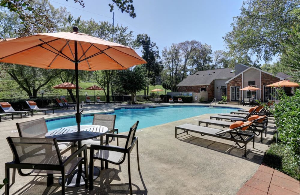 Shaded seating and chaise lounge chairs near the swimming pool at Allegro on Bell in Antioch, Tennessee