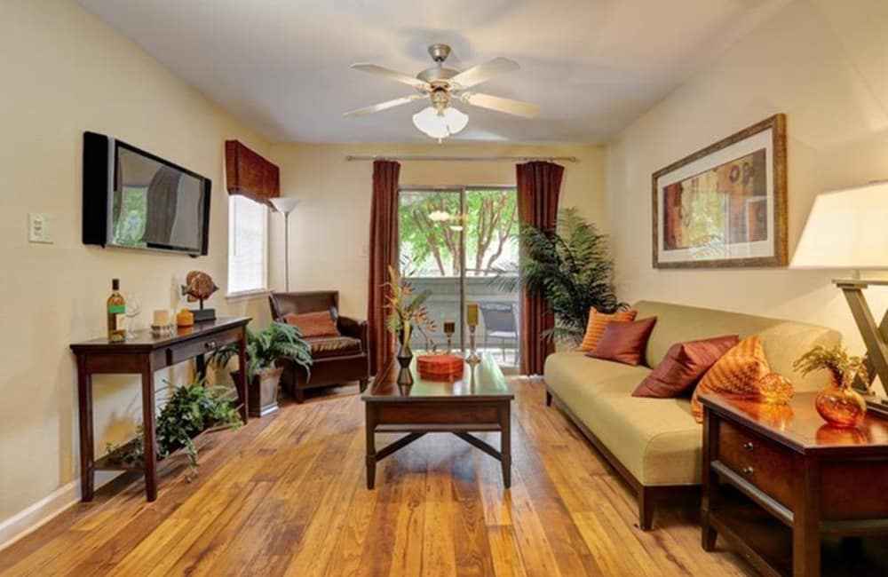Ceiling fan and hardwood floors in open-concept floor plan of model home at Allegro on Bell in Antioch, Tennessee