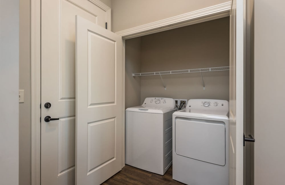 A full sized washer and dryer in an apartment at Boulders at Overland Park Apartments in Overland Park, Kansas