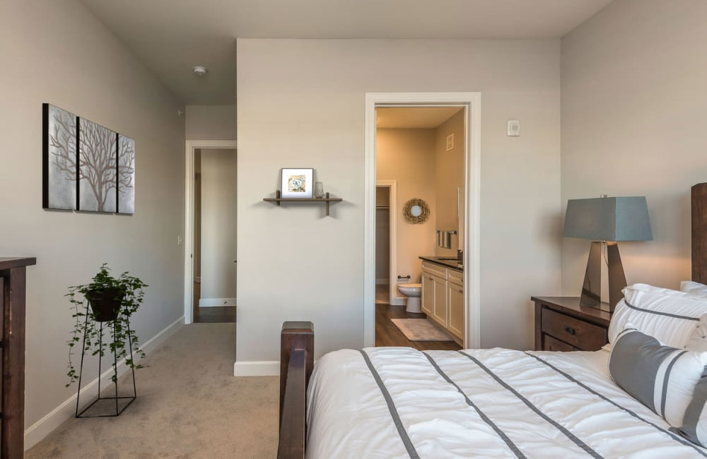 A bedroom with an attached bathroom at Boulders at Overland Park Apartments in Overland Park, Kansas