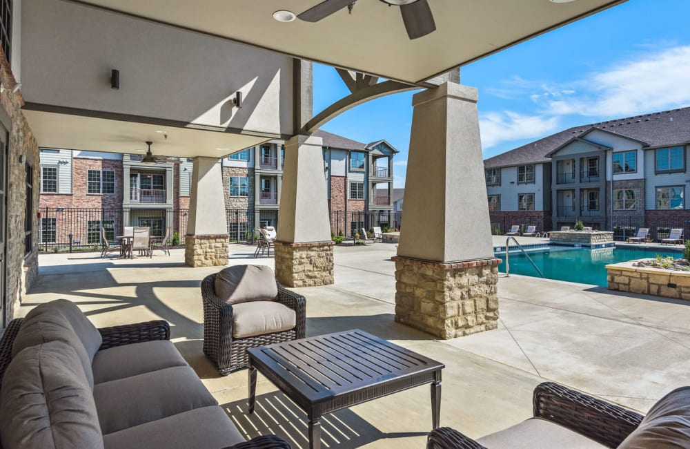 Covered poolside seating at Boulders at Overland Park Apartments in Overland Park, Kansas