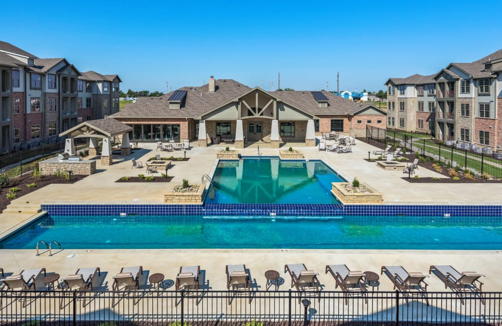 The community swimming pool at Boulders at Overland Park Apartments in Overland Park, Kansas